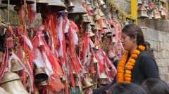 Pilgrims ring bells at temple,Dakshinkali,Nepal Stock Footage