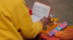 Hindu priest reading book,Dakshinkali,Nepal Stock Footage