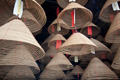 Incense coils hanging in market stall Stock Photos