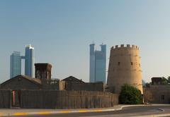 Old Arab fortress and modern skyscrapers, Abu Dhabi, United Arab Emirates Stock Photos