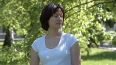 Woman pinning teal awareness ribbon Stock Footage