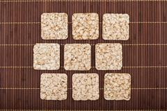 Composition of square nine crunchy rye crispbreads Stock Photos