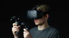 Man Wearing Virtual Reality Headset In Studio Shot On R3D Stock Footage