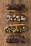 Chocolate eclairs with toppings Stock Photos