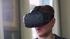 Man At Home Wearing Virtual Reality Headset Shot On R3D Stock Footage