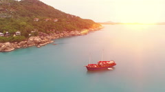 Aerial view of amaizing island in Thailand and red sail ship Stock Footage