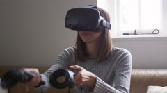 Woman At Home Wearing Virtual Reality Headset Shot On R3D Stock Footage