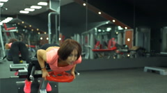 Attractive female does hyperextension at the gym slow motion Stock Footage