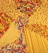 Assortment of colored uncooked Italian pasta as background - stock photo