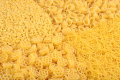 Assortment of uncooked Italian pasta close up - stock photo