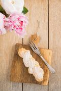 Eclair with buttercream filling Stock Photos