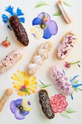 Eclairs with toppings Stock Photos