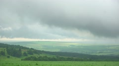 Summer green field with low clouds Stock Footage