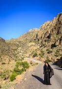 Lone woman on a mountain road Stock Photos
