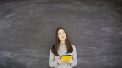 4K Portrait smiling woman with tablet computer on blank chalkboard background Stock Footage