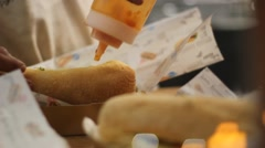 Closeup of hands stuffing sandwiches Stock Footage