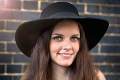 Portrait of young woman with hat and nose ring stud Stock Photos