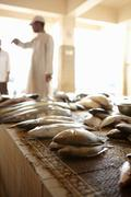 Stall holders in local fish market, Muttrah, Muscat, Oman, Middle East Stock Photos
