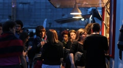 People queuing for street food in the evening Stock Footage