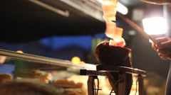 Closeup of hands slicing prosciutto in backlight Stock Footage