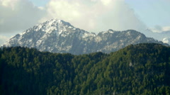 Snowy Peak above Forest Mountains - 25FPS PAL Stock Footage