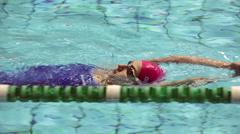 RUSSIA, MOSCOW- 5 MARCH, 2016: Girl in swimming goggles swimming on her back in Stock Footage
