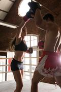 Man woman training gym boxing mma ring pads mixed martial arts fitness Stock Photos