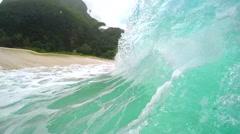 SLOW MOTION UNDERWATER: Emerald wave breaking on sandy seabed at Hawaii island Stock Footage