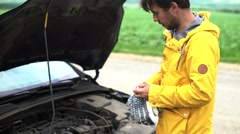 Man puts on gloves and prepares to repair the car Stock Footage