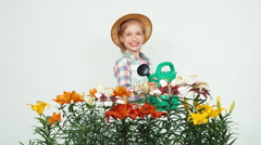 Close-up portrait flower-girl holding watering can laughing at camera Stock Footage