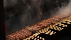 Closeup of smoky meat skewers on smoldering coals Stock Footage