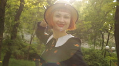 Beautiful redhead young woman dancing, whirling, swinging, smiling, flirting - stock footage