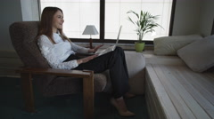 Adult woman at home talking with friend or family via internet Stock Footage