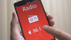 4K Radio app Listening on Smartphone Stock Footage
