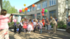 Children release colorful balloons into the sky - stock footage