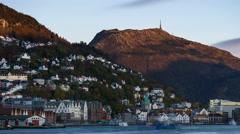 Bjoergvin | Dusk over Bryggen & Ulriken Stock Footage