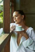 Sexy white shirt window, looking, out coffee tea cup view beautiful pondering Stock Photos