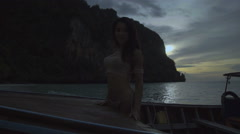Video of sexy girl standing on the boat at the sunset in slow motion. - stock footage