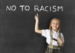 Young sweet junior schoolgirl with blonde no to racism message Stock Photos