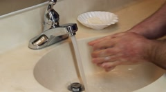 Washing hands with soap and water - stock footage