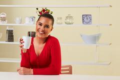 Beautiful healthy woman drinking coffee or tea in a mug Stock Photos