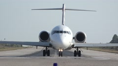 Front view of airplane coming closer on airport runway Stock Footage