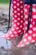Rubber boots are a pool in the summer - stock photo