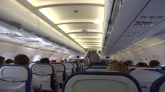 Airplane indoor in flight, many chairs Stock Footage
