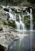 A tranquil and beautiful outdor enviroment with a waterfall for hiking and ca - stock photo