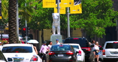Tourists explore Rodeo Drive and traffic in Beverly Hills during heat wave 4K Stock Footage