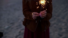 SLOW MOTION: Portrait of a girl model looks with sparklers in their hands Stock Footage