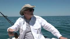 Senior man sailing his boat Stock Footage