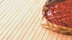 Cutting of a strawberry pie using a steel knife Stock Footage