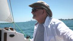 Senior aged man sailing his boat, close up shot - stock footage